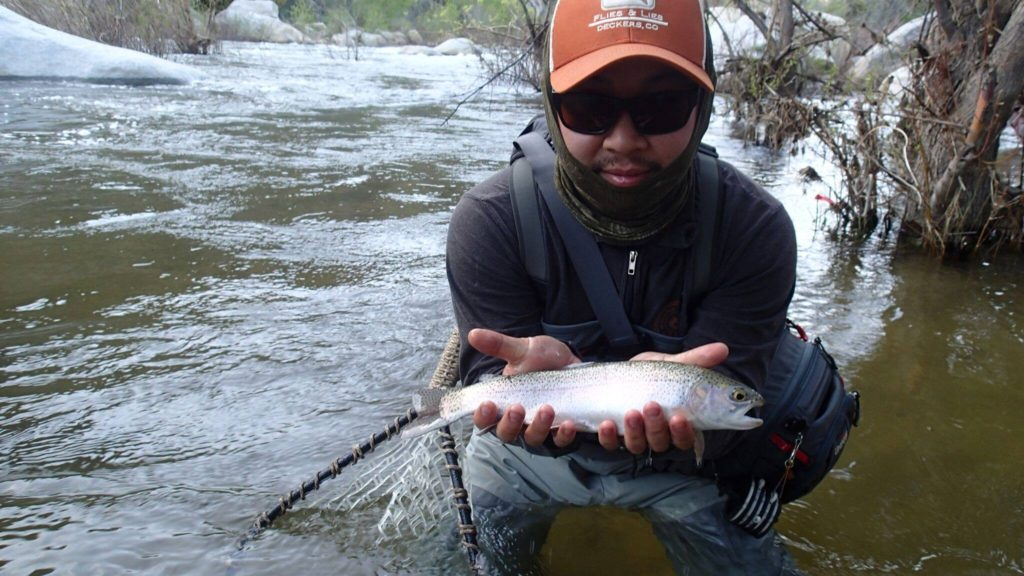 Phillip with a nice rainbow from the upper river.